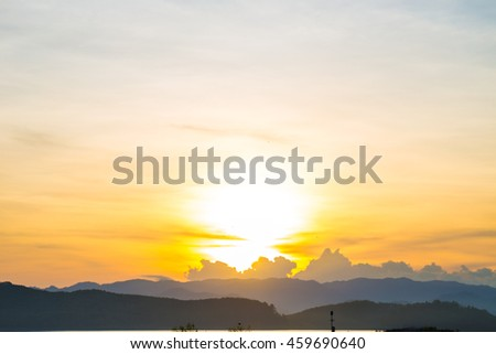 Mountain sunrise silhouette scene in reservoir background with mountain, Natural landscape - stock photo