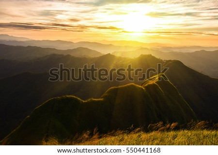 mountain sunset and colored sky with clouds : Khao Chang Puak of Thong Pha Phum National Park. Kanchanaburi, Thailand