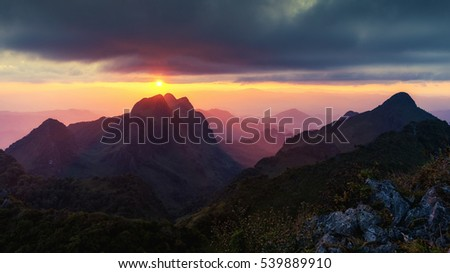 Mountain sunset landscape,Nature outdoor in wonderland,Mountain range in morning landscape,Thailand mountain travel for trekking vacation,Sunset scenic and dramatic skylight,Focus on foreground.