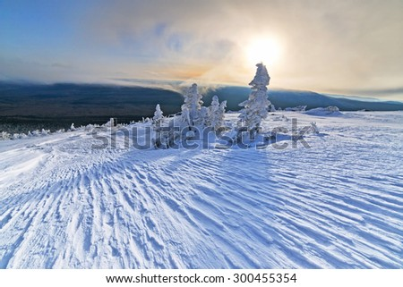 Mountain Taganay in the southern Urals, Russia in winter at sunrise. - stock photo