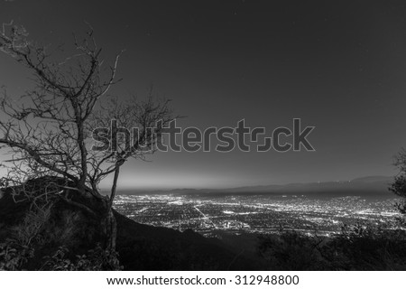 Mountain top night view of Burbank and North Hollywood, California.   - stock photo