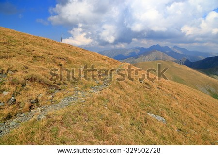 Mountain trail in Fagaras mountains, Romania - stock photo
