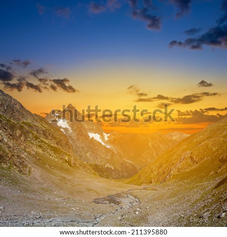 mountain valley at the sunset - stock photo