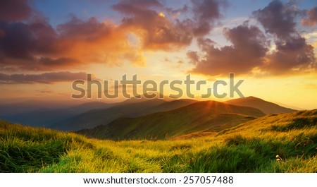 Mountain valley during bright sunrise. Beautiful natural landscape - stock photo