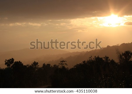 Mountain valley during sunrise. Natural it's raining landscape