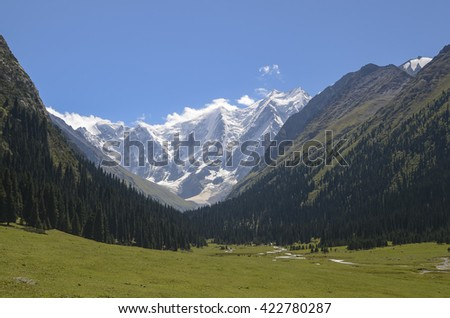 Mountain valley in picturesque mountains in Tian Shan mountain, Karakol, Kyrgyzstan, Central Asia. Sunny meadow in the valley Jety-Oguz, Altyn Arashan Mountain