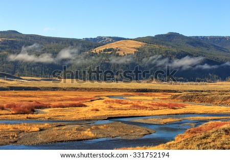 Mountain valley landscape with river, Yellowstone National Park. - stock photo