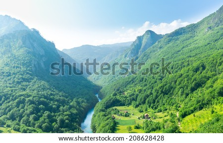 Mountain valley with beautiful blue sky - stock photo