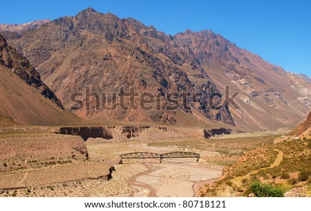 Mountain valley with seared riverbed in the Andes, Argentina, South America - stock photo
