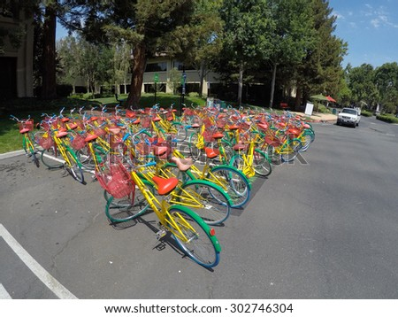 MOUNTAIN VIEW, CA - AUGUST 1, 2015: Bikes used by Google employees to navigate Google headquarters, also known as Googleplex, in Mountain View, California on August 1 2015