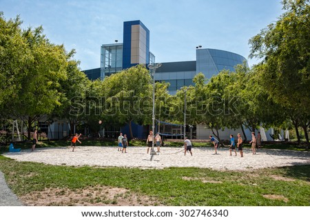 MOUNTAIN VIEW, CA - AUGUST 1, 2015: Google employees play volleyball at Google headquarters in Mountain View, California on August 1 2015 - stock photo