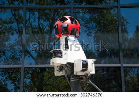 MOUNTAIN VIEW, CA - AUGUST 1, 2015: Google's Street View cameras mounted ona car on display at Google headquarters in Mountain View, California on August 1 2015 - stock photo