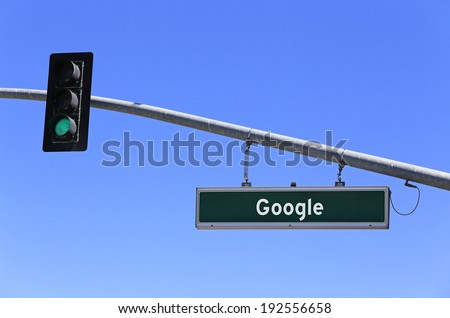 MOUNTAIN VIEW, CA - MARCH 18: A sign in front of the Google world headquarters complex on March 18, 2014. Google is a multinational corporation specializing in Internet-related services and products. - stock photo