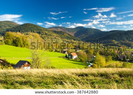Mountain village as marvelous landscape with clear blue sky and Lysa hora summit - Moravian-Silesian Beskydy - stock photo