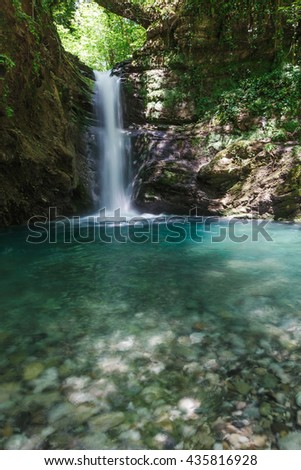 Mountain waterfall in Sunny day