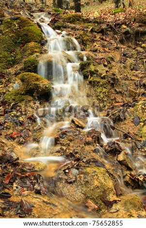 Mountain waterfall in the forest - stock photo