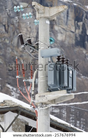 Mountain white snow Electric Power Lines connector high voltage electicity - stock photo