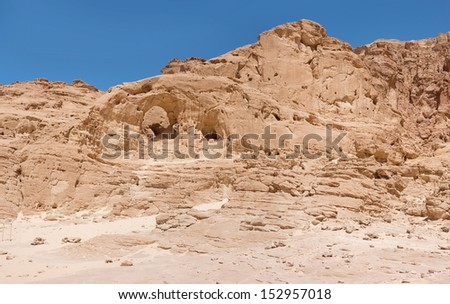 Mountain with circular arch, Timna, Israel, Panorama - stock photo