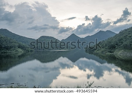 mountain with lake in sunset