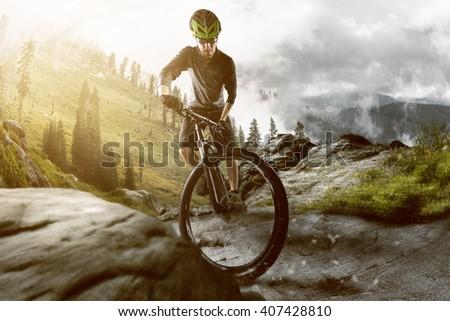 Mountainbiker in the mountains - stock photo
