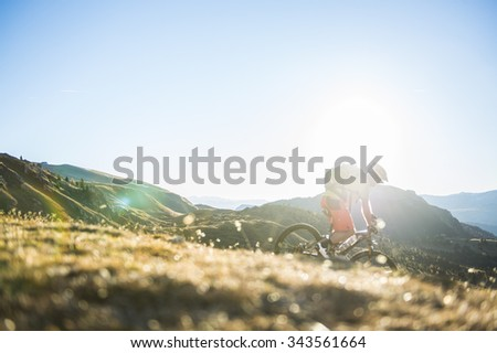mountainbiker races in the valley - stock photo