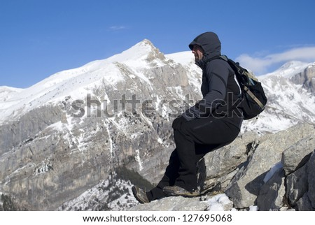 Mountaineer admiring the view after trek - stock photo