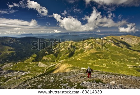 Mountaineer back to the valley with a nice day - stock photo