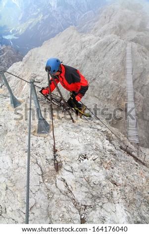 "Mountaineer on via ferrata ""Ivano Dibona"", Dolomite Alps, Italy - stock photo"