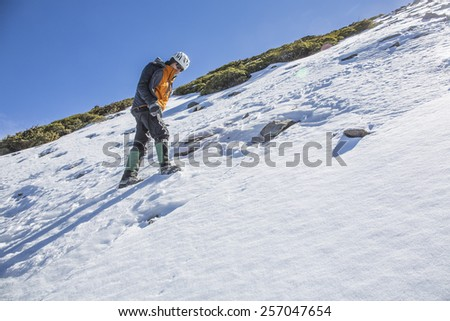 Mountaineer practice snow steps on snowy mountain slop. - stock photo