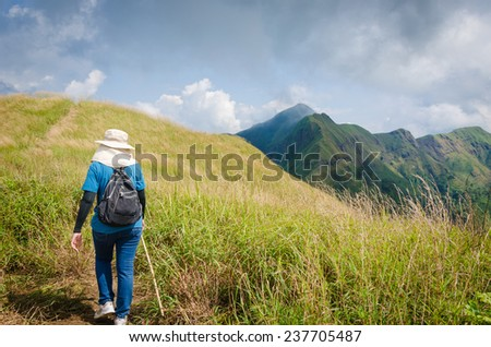 Mountaineer tourists hiking on (Khao Chang Puak) of mountains at Kanchanaburi, Thailand.
