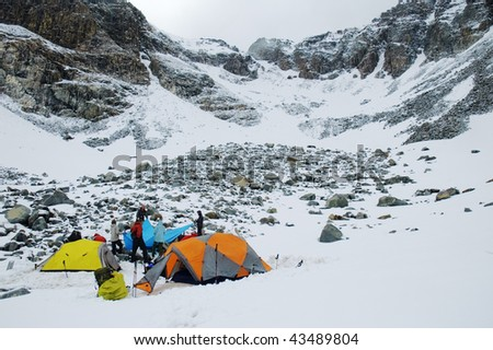 Mountaineering camp at a snow-covered mountain circus. Kuylu mountains, Central Tien-Shan, Kyrgyzstan.