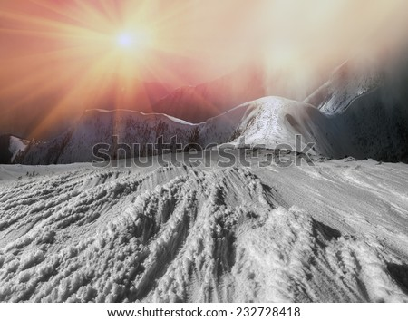 Mountaineering- for the brave people that requires experience and knowledge to survive in the cold, thin air and the wind and the lack of visibility, the possibility of falling off a cliff  - stock photo