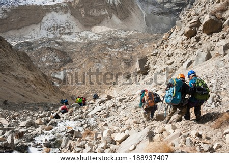 Mountaineering group descending from Tharpu Chuli high camp, Annapurna region, Nepal