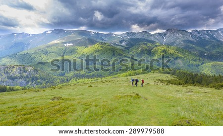 Mountaineers analyzing bad weather in summer day - stock photo