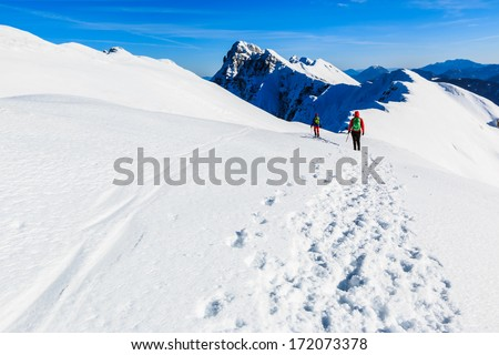 Mountaineers walking on the Kosuta ridge in Karavanke range, Slovenia