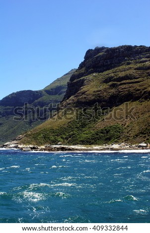 Mountainous coastline seen from the water at False Bay, near Cape Town, South Africa - stock photo