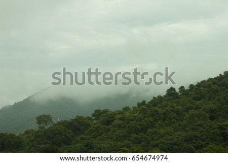 Mountainous scenery with clouds running after rain