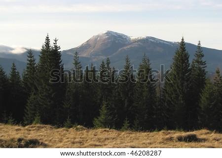 Mountainous summit. Mount Petros in the East Carpathian mountains. Mountainous landscape in the autumn. - stock photo