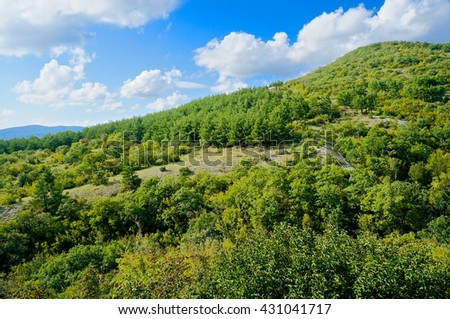 Mountains and blue sky with clouds in summer, Russia