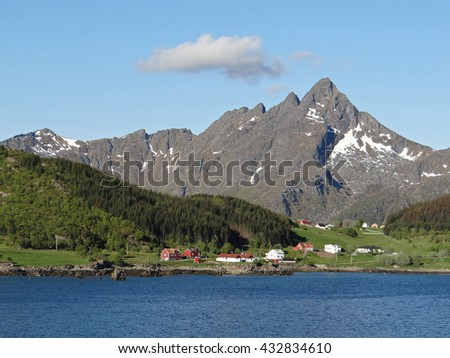mountains and farms in leknes, norway - stock photo