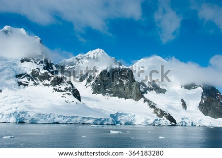 Mountains and ices of Antarctica in a beautiful sunny day