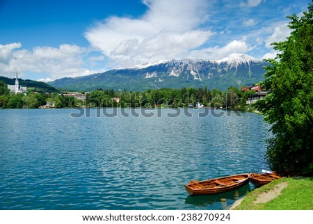 Mountains and lake with blue sky and snow - stock photo