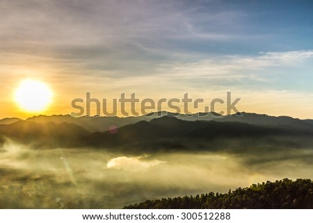Mountains and mist with sunset time in Thailand - stock photo
