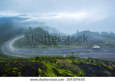 Mountains and natural beauty in the rain. Both the mist and sunshine in the morning. - stock photo