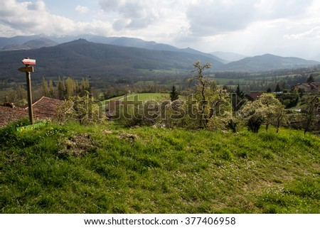 Mountains and sign with a trail  in French Pyrenees  - stock photo