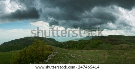 mountains and the sky green slopes and clouds - stock photo