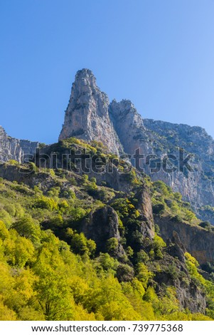 mountains and trees of Vikos gorge in greece in autumn colors