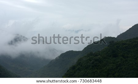 Mountains and valley with clouds and fogs