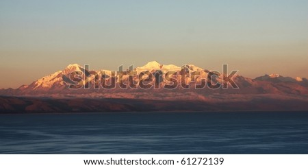 mountains at sunset on titicaca lake - stock photo