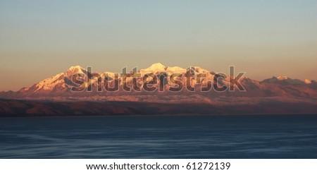 mountains at sunset on titicaca lake - stock photo